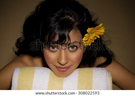 Woman relaxing at a spa - stock photo