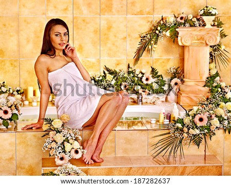 Woman relaxing at flower water spa. - stock photo