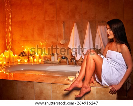 Woman relaxing at home luxury bath. Burning candle. - stock photo