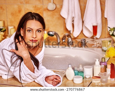 Woman relaxing at home luxury bath. Long hair. - stock photo