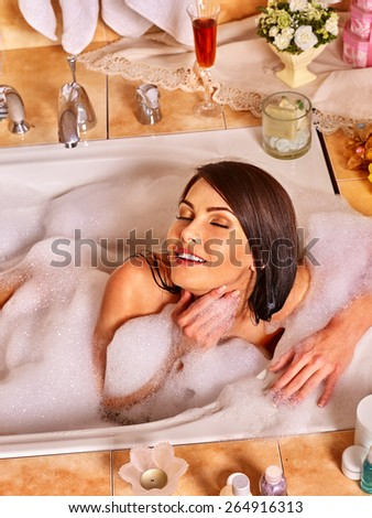 Woman relaxing at home luxury bath. Top view. - stock photo