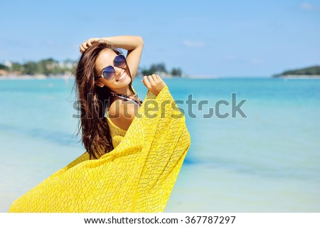 Woman relaxing at the beach, enjoying summer freedom - stock photo