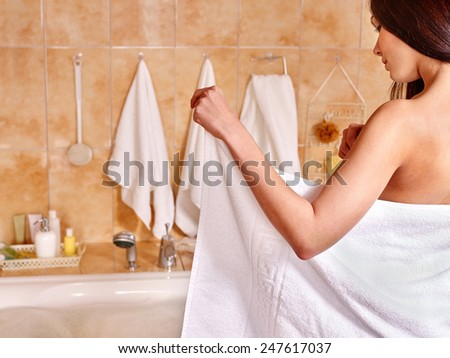 Woman relaxing at water in bubble bath.Girl takes bath towel before - stock photo