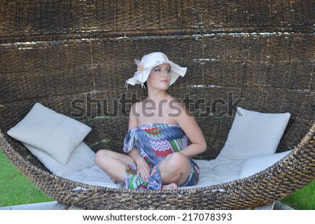 Woman relaxing enjoying luxury lifestyle outdoor in Bamboo bed  - stock photo