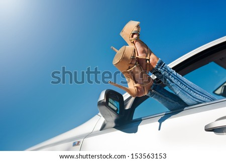 Woman relaxing in a car  - stock photo
