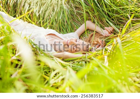 woman relaxing in a meadow - stock photo