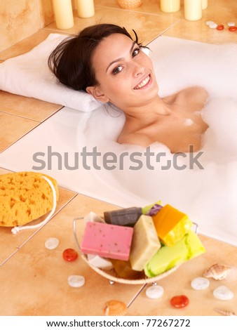 Woman relaxing in bubble bath . - stock photo