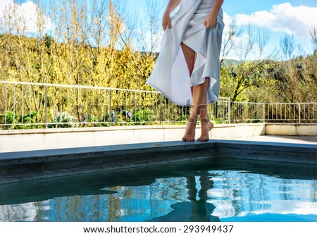 Woman relaxing in natural thermal water pool of spa. Tuscany. Italy - stock photo
