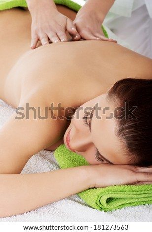 Woman relaxing in spa saloon - beeing massaged - stock photo