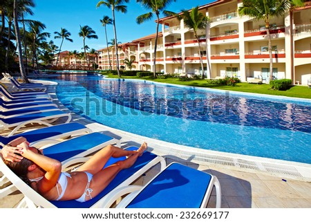 Woman relaxing near the pool. Vacation at caribbean resort - stock photo