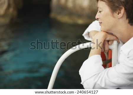 Woman Relaxing on Boat - stock photo