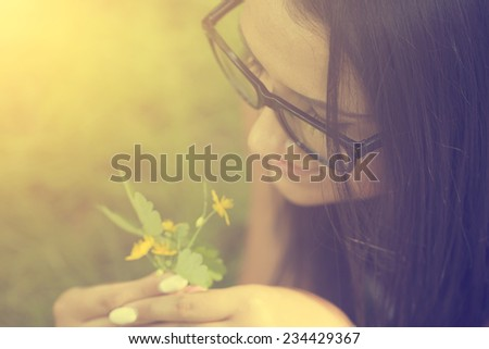 Woman relaxing on grass - stock photo