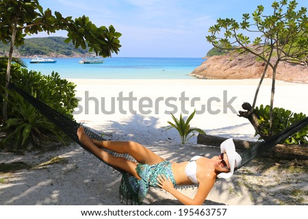 Woman relaxing on hammock - stock photo