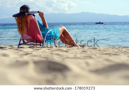 Woman relaxing on the beach chair  - stock photo