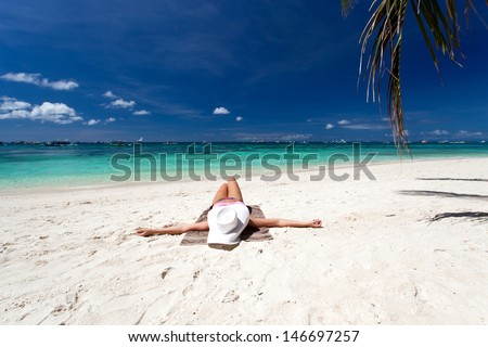 Woman relaxing on tropical beach - stock photo