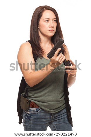 Woman reloading her gun with a magazine of ammunition | Attractive female shooter holding handgun against white background. - stock photo