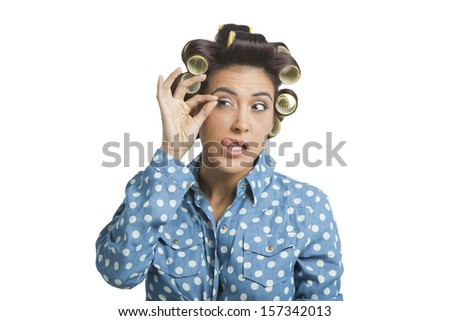 Woman removing her false eyelashes  - stock photo