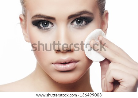 Woman removing make-up - stock photo