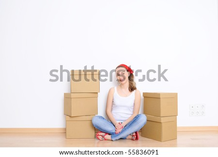 Woman resting from moving into a new home. Great copy space. - stock photo
