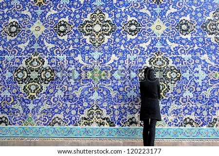 Woman restores old mosaic - stock photo