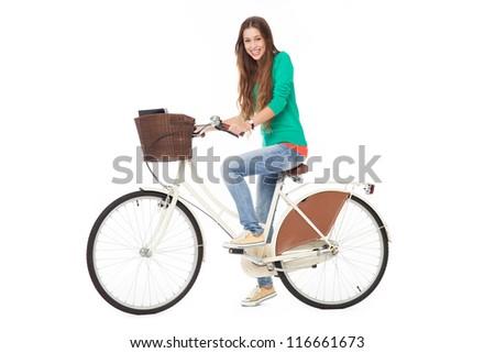 Woman riding a bike - stock photo