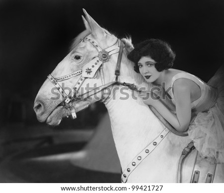 Woman riding horse - stock photo