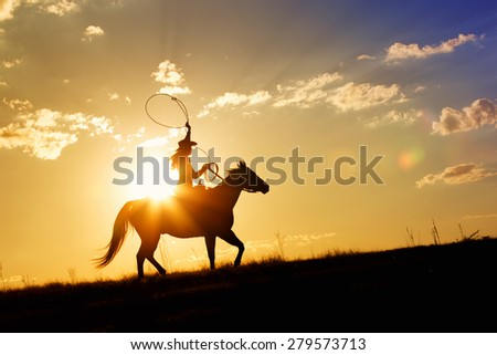 Woman riding horse over range at sunset or sunrise with a bright vivid horizon in the background - stock photo