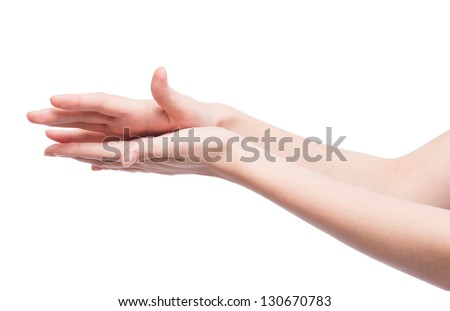 Woman rubs hand cream, makes a hand massage - stock photo