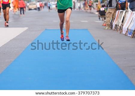 Woman runner marathon running to finish line.Marathon runner. - stock photo