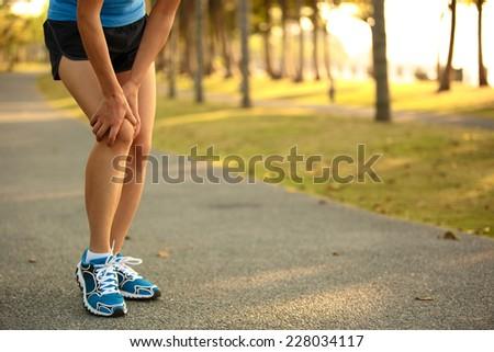 woman runner sports injured leg  - stock photo