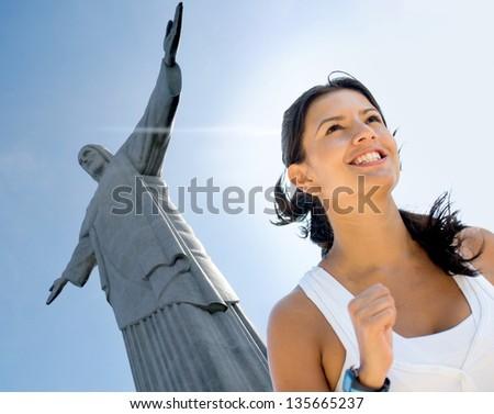 Woman running a marathon in Rio de Janeiro - stock photo