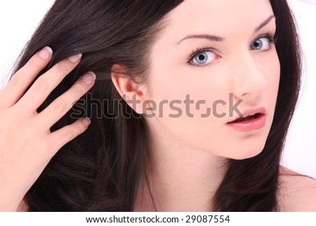 Woman running fingers through hair - stock photo