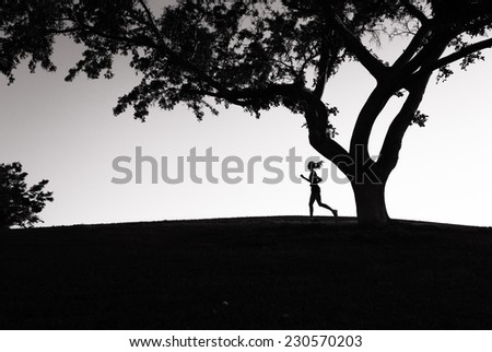 Woman running in the park - stock photo