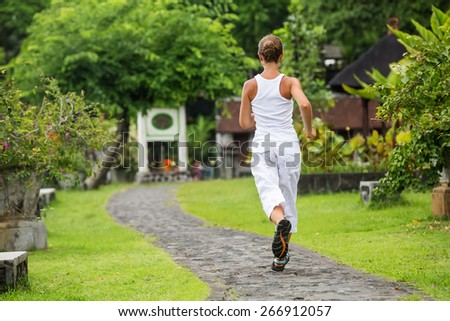 Woman Running In Tirta Ganga in Bali - stock photo