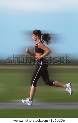 Woman running outdoor(motion blur background) - stock photo
