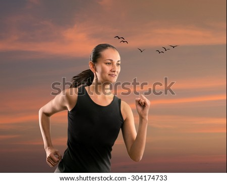 Woman running outdoors against beautiful sky - stock photo