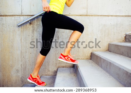 Woman running up the stairs, interval training - stock photo
