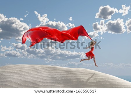 woman running with a red tissue  - stock photo