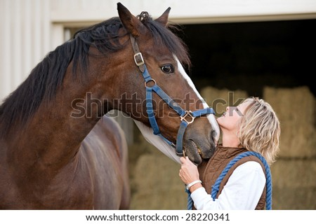 Woman's and Horse's Faces Together - stock photo