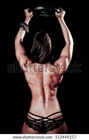 Woman's Back Muscles lifting weights - stock photo