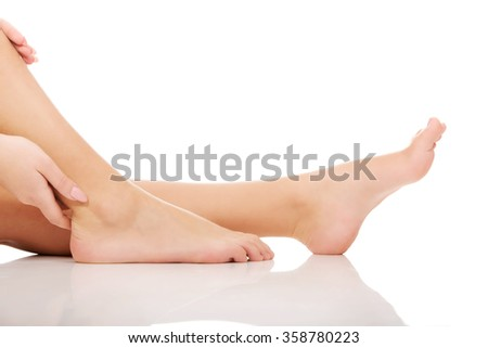 Woman's bare feet. - stock photo