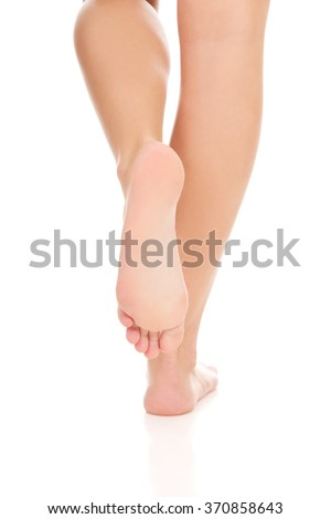 Woman's bare feet. - stock photo