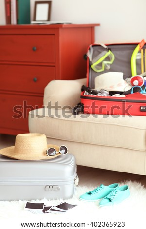 Woman's clothes in a red suitcase, close up - stock photo