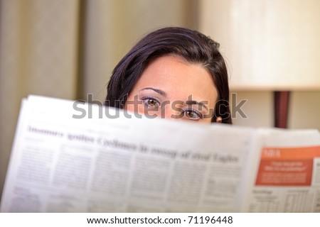 Woman's eyes reading - stock photo