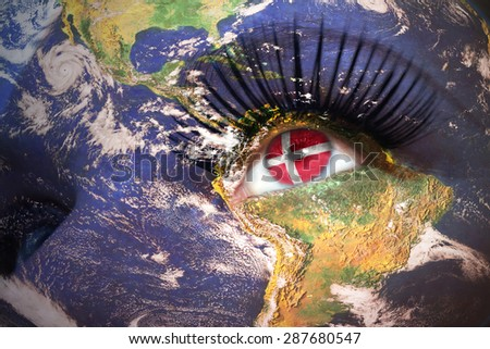 woman's face with planet Earth texture and danish flag inside the eye. Elements of this image furnished by NASA. - stock photo