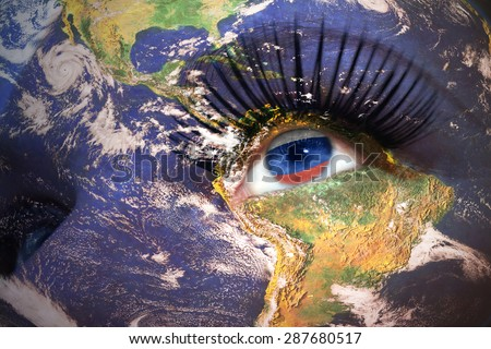 woman's face with planet Earth texture and russian flag inside the eye. Elements of this image furnished by NASA. - stock photo