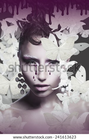 Woman's Face with Teardrops over Abstract Background - stock photo