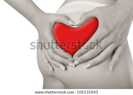 Woman's fingers touching her body parts in the shape of a heart isolated on white background - stock photo