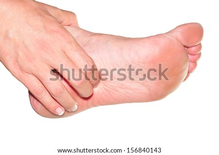 woman's hand being massaged a foot     - stock photo