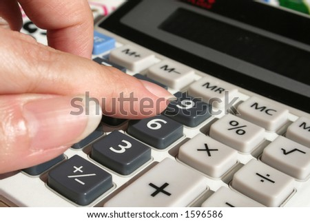woman's hand calculating on calculator - stock photo